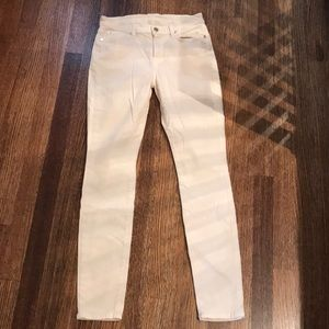 Excellent used condition cream jeans.